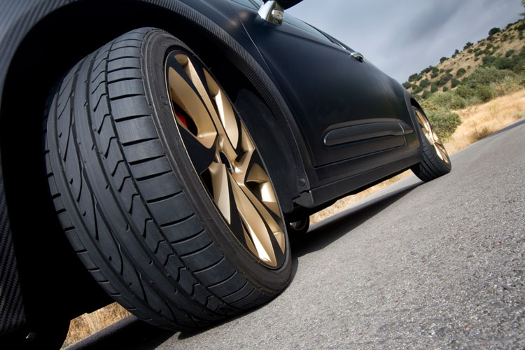 luxuary-car-tires-close-up-road